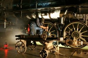 worker fixing locomotive