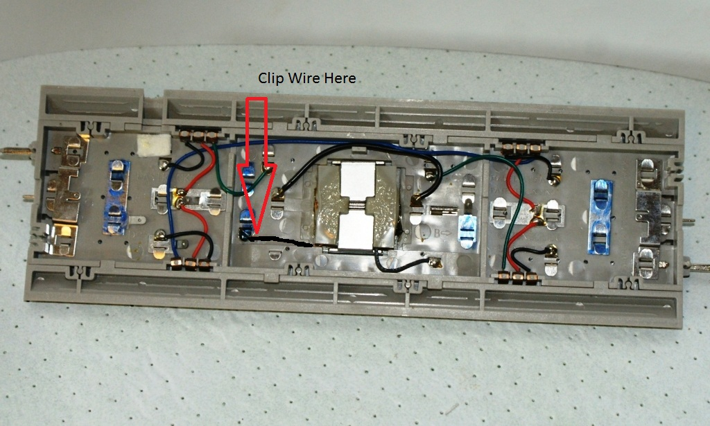 wiring a lionel otc to a fastrack operating track lionel trains clip the wire from the coil to the operating rails where shown er a new wire here to connect to the otc click on photo to enlarge
