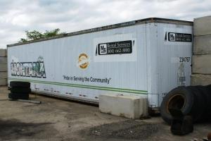 Boxcars and now intermodal trailers are common storage solutions. This one also forms part of a wall.