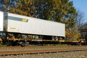"""The 89' flatcar became an intermodal standard in the 1980s. The ACF-built """"F89-J"""" class cars were some of the most distinctive. A modern 53' trailer creates a loading challenge however."""
